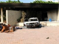 A burnt house and a car are seen inside the US Embassy compound on September 12, 2012 in Benghazi, Libya following an overnight attack on the building. The US ambassador to Libya and three of his colleagues were killed in an attack on the US consulate in the eastern Libyan city by Islamists outraged over an amateur American-made Internet video mocking Islam, less than six months after being appointed to his post. AFP PHOTO/STRINGER (Photo credit should read