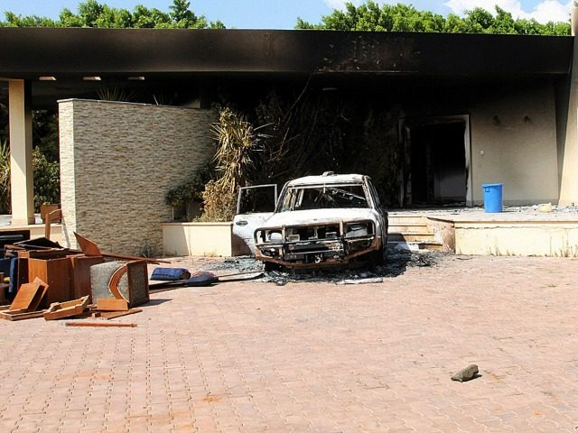 A burnt house and a car are seen inside the US Embassy compound on September 12, 2012 in Benghazi, Libya following an overnight attack on the building. The US ambassador to Libya and three of his colleagues were killed in an attack on the US consulate in the eastern Libyan …