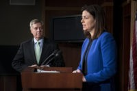 US Senator Lindsey Graham listens while Senator Kelly Ayotte speaks during a press conference on Capitol Hill March 7, 2013 in Washington, DC. The lawmakers spoke about the reported arrest of Sulaiman Abu Ghaith, the son-in-law of Osama Bin Laden, who was taken into custody in the Middle East and is now allegedly being held in New York. AFP PHOTO/Brendan SMIALOWSKI        (Photo credit should read BRENDAN SMIALOWSKI/AFP/Getty Images)