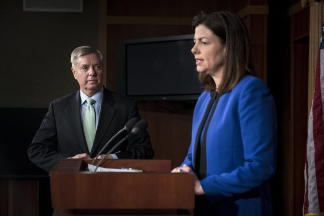 US Senator Lindsey Graham listens while Senator Kelly Ayotte speaks during a press conference on Capitol Hill March 7, 2013 in Washington, DC. The lawmakers spoke about the reported arrest of Sulaiman Abu Ghaith, the son-in-law of Osama Bin Laden, who was taken into custody in the Middle East and …