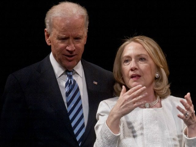 Secretary of State Hillary Clinton and Vice President Joe Biden speak at the end of the Vital Voices Global Awards ceremony at the Kennedy Center in Washington on April 2, 2013.