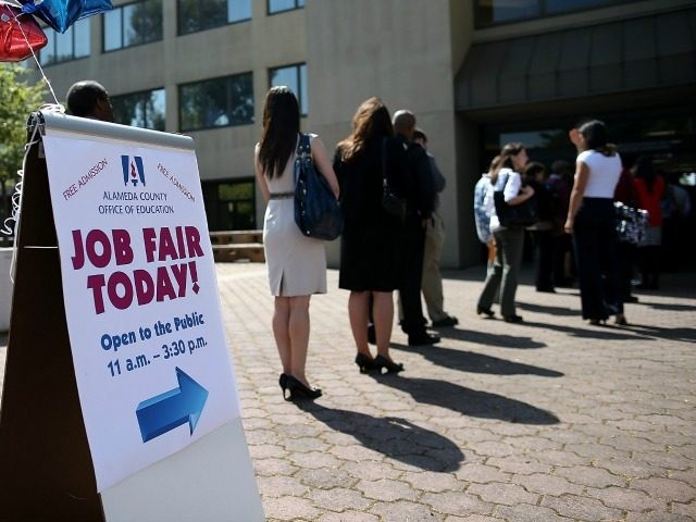 Job seekers line up to enter a job fair at the Alameda County Office of Education on April 24, 2013 in Hayward, California. Over 100 job seekers attended the annual education job fair hosted by the Alameda County Office of Education where 200 jobs were available ranging from teachers to …