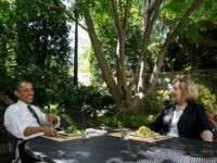 In this handout provided by the White House, U.S. President Barack Obama has lunch with former Secretary of State Hillary Rodham Clinton on the patio outside the Oval Office, July 29, 2013 in Washington, D.C.