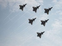 J-10 fighter jets of the Bayi Aerobatic Team of PLA's (Peoples Liberation Army) Air Force perform during a flight at the Airshow China 2014 in Zhuhai, south China's Guangdong province on November 11, 2014. Global aviation firms flocked to China on November 11 to show off their wares as economic …