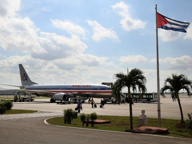 Passengers walk across the tarmac at Jose Marti International Airport after arriving on a charter plane operated by American Airlines January 19, 2015 in Havana, Cuba.