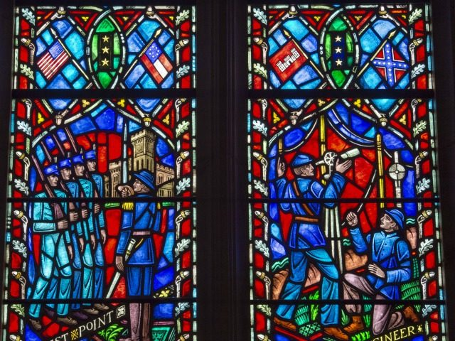 This stained glass window on June 25, 2015, at The Washington National Cathedral in Washington, DC, depicts the life of US Civil War General Robert E. Lee, Commander of the Army of Northern Virginia. The dean of The National Cathedral, Reverend Gary Hall, called on June 25 for two stained …