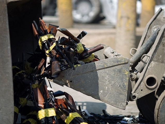 RANCHO CUCAMONGA, CA - JUNE 26: Tractors scoop up guns during the destruction of approximately 3,400 guns and other weapons at the Los Angeles County Sheriffs' 22nd annual gun melt at Gerdau Steel Mill on July 6, 2015 in Rancho Cucamonga, California. The weapons, confiscated in various law enforcement operations, …