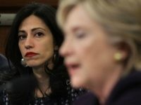 WASHINGTON, DC - OCTOBER 22: Long-time aide to Democratic presidential candidate and former Secretary of State Hillary Clinton, Huma Abedin (L), looks on as Clinton testifies before the House Select Committee on Benghazi October 22, 2015 on Capitol Hill in Washington, DC.
