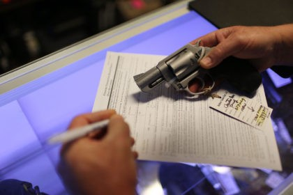 DELRAY BEACH, FL - JANUARY 05: Mark O'Connor fills out his Federal background check paperwork as he purchases a handgun at the K&W Gunworks store on the day that U.S. President Barack Obama in Washington, DC announced his executive action on guns on January 5, 2016 in Delray Beach, Florida. …