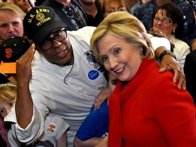 U.S. Army veteran Basil Kimbrew poses with Democratic presidential candidate Hillary Clinton after she spoke at a get-out-the-caucus event at the Mountain Shadows Community Center on February 14, 2016 in Las Vegas, Nevada. Clinton is challenging Sen. Bernie Sanders for the Democratic presidential nomination ahead of Nevada's February 20th Democratic …