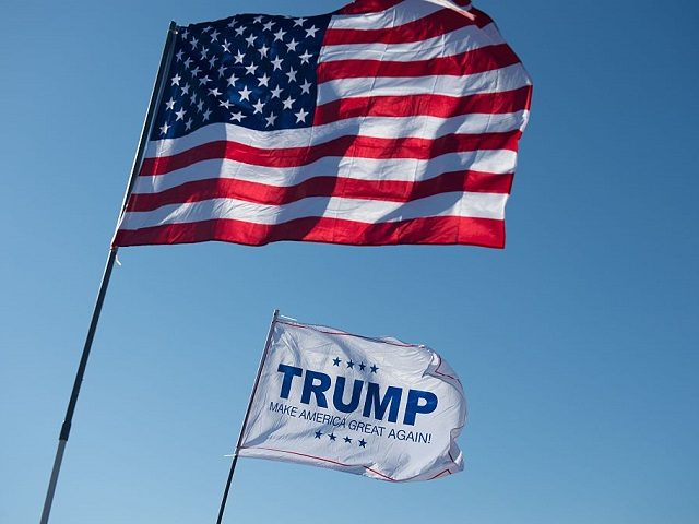 An American Flag and a Donald Trump flag wave outside a Donald Trump rally at Millington Regional Jetport on February 27, 2016 in Millington, Tennessee. / AFP / Michael B. Thomas (Photo credit should read MICHAEL B. THOMAS/AFP/Getty Images)