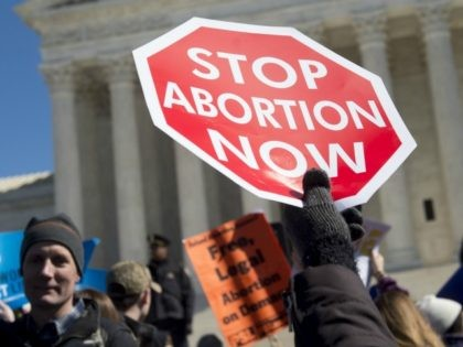 Anti-abortion activists rally outside of the Supreme Court in Washington, DC, March 2, 2016, following oral arguments in the case of Whole Woman's Health v. Hellerstedt, which deals with access to abortion in Texas. The US Supreme Court on March 2 took up its most important abortion case in a …