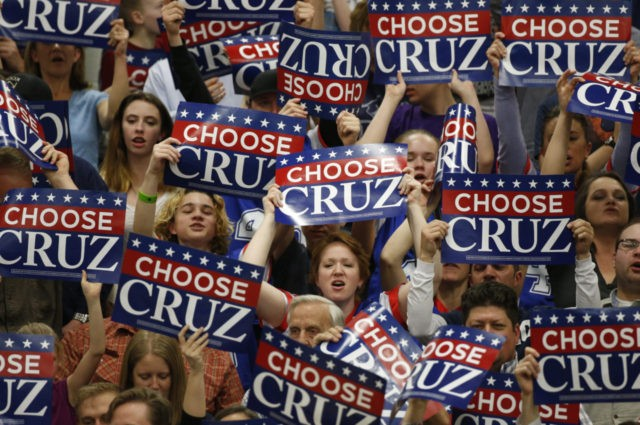 PROVO - MARCH 19: Supporters wave signs as Republican presidential candidate Sen. Ted Cruz (R-TX) speaks at a campaign rally on March 19, 2016 in Provo, Utah. The Republican and Democratic caucus will be held in Utah on Tuesday March 22, 2016. (Photo by George Frey/Getty Images