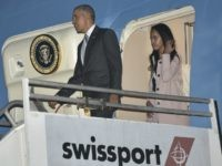 resident Barack Obama and his daughter Malia step off Air Force One upon arrival at Los Angeles International Airport in Los Angeles on April 7, 2016.