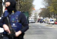 Belgian police officers stand guard in a street in Etterbeek, Brussels, as part of the investigation into the November 13 Paris attacks in which 130 died and the March 22 attacks which left 32 dead in Brussels. A sixth person was arrested during raids on April 8 over the Brussels …