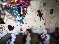Syrian school girls sit at their classroom at the Saif al-Dawla school as they take part in activities surrounding an art competition organised as part of a local initiative to shift the children's minds from the atrocities of the Syrian war, on May 25, 2016, in the besieged rebel bastion …