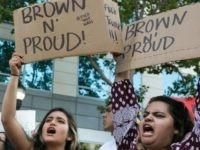 """SAN JOSE, CA - JUNE 02: Protesters hold up signs that say """"Brown n' Proud"""" outside a campaign rally for Republican Presidential candidate Donald Trump on June 2, 2016 in San Jose, California. Trump is campaigning in California ahead of the states June 7th Republican primary. (Photo by"""