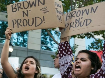 "SAN JOSE, CA - JUNE 02: Protesters hold up signs that say ""Brown n' Proud"" outside a campaign rally for Republican Presidential candidate Donald Trump on June 2, 2016 in San Jose, California. Trump is campaigning in California ahead of the states June 7th Republican primary. (Photo by"