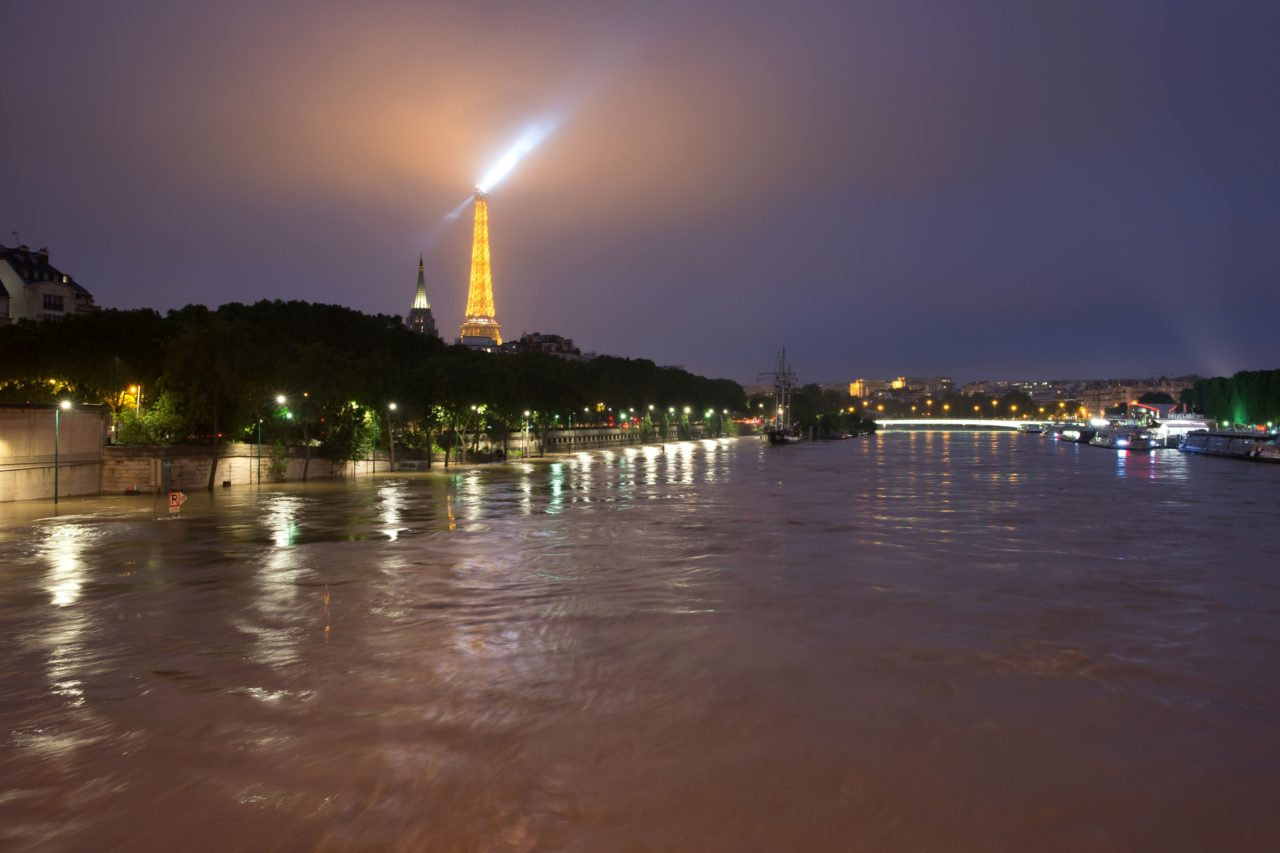 A photo taken late on June 2, 2016 shows water rising near the Eiffel Tower at the Alma bridge in Paris. The rain-swollen River Seine in Paris reached its highest level in three decades on June 3, 2016, spilling its banks and prompting the Louvre museum to shut its doors and evacuate artworks in its basement. Parisians were urged to avoid the banks of the river which was expected to reach a peak of six metres (19 feet) Friday, while deadly floods continued to wreak havoc elsewhere in France and Germany.  / AFP / Laurent Kalfala        (Photo credit should read LAURENT KALFALA/AFP/Getty Images)
