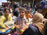 Iraqis who fled the violence in their village of Saqlawiyah, north west of Fallujah, wait to receive food and aid at a military point outside their village, on June 3, 2016. Iraqi forces launched an offensive a week ago to recapture Fallujah, which became an Islamic State group stronghold after …