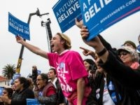 SAN FRANCISCO, CA - JUNE 06: Audience members at a rally held by Democratic presidential candidate Senator Bernie Sanders at the Presidio cheer while waiting for Sanders to arrive on June 6, 2016 in San Francisco, California. California's primary will be held tomorrow. (Photo by