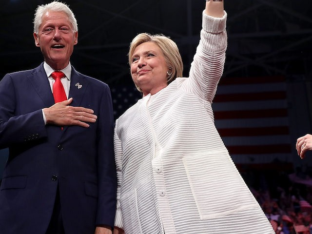 BROOKLYN, NY - JUNE 07: Democratic presidential candidate former Secretary of State Hillary Clinton (R) and her husband former U.S. president Bill Clinton greet supporters during a primary night event on June 7, 2016 in Brooklyn, New York. Hillary Clinton surpassed the number of delegates needed to become the Democratic …