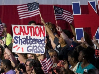 Supporters cheer before the arrival of Democratic presidential candidate Hillary Clinton during a primary night rally at the Duggal Greenhouse in the Brooklyn Navy Yard, June 7, 2016 in the Brooklyn borough of New York City. Clinton has secured enough delegates and commitments from superdelegates to become the Democratic Party's …