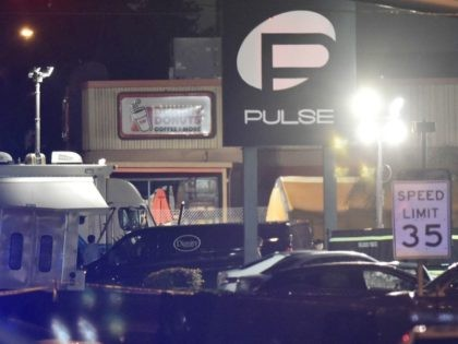 A van from a funeral service is seen infront of the Pulse club in Orlando, Florida,on June 12, 2016. Fifty people died when a gunman allegedly inspired by the Islamic State group opened fire inside a gay nightclub in Florida, in the worst terror attack on US soil since September …