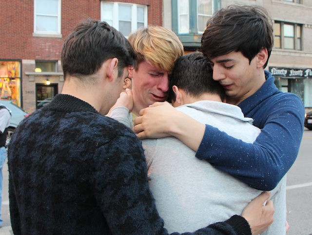 Mourners cry during a vigil around a makeshift memorial in the Lakeview neighbourhood, the epicentre of the citys gay culture, in Chicago, Illinois on June 12, 2106, in remembrance of the victims of the gay nightclub shooting in Orlando, Florida. Fifty people died when a gunman allegedly inspired by the …