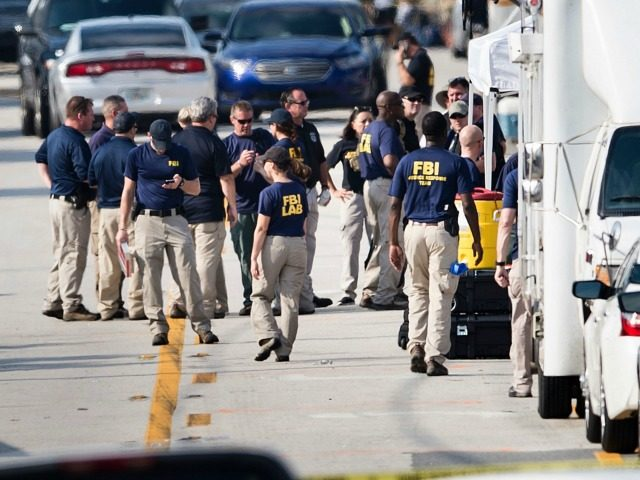 Members of the FBI gather near the Pulse nightclub June 13, 2016 in Orlando, Florida. Forty-nine people died and more than 50 were injured early June 12 when a heavily-armed gunman opened fire and seized hostages at a gay nightclub in Orlando, Florida, in the worst mass shooting in US …