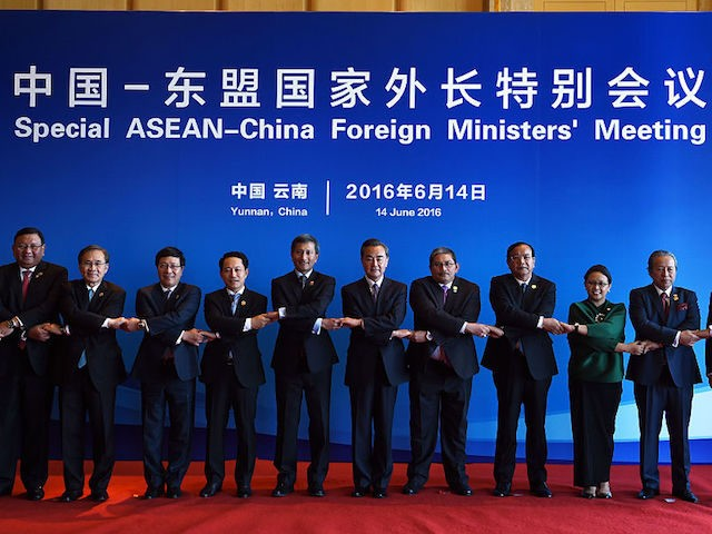 "Chinese Foreign Minister Wang Yi (6th R) and foreign ministers from ASEAN-member nations pose for a group photo during a special ASEAN-China foreign ministers' meeting in Yuxi, southwest China's Yunnan Province on June 14, 2016. Countries in Southeast Asia have ""serious concerns"" over recent events in the disputed South China …"