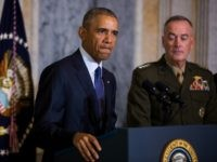 President Barack Obama (L) speaks on the Orlando shooting at the Treasury Department while Chairman of the Joint Chiefs of Staff General Joseph Dunford (R) look on, on June 14, 2016 in Washington, DC.