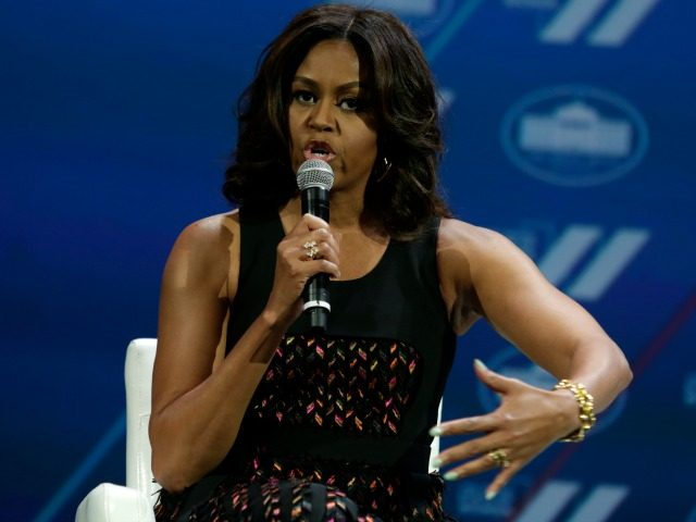 Michelle Obama speaks at the White House Summit on the United State of Women in Washington, DC on June 14, 2016. / AFP / YURI GRIPAS (Photo credit should read