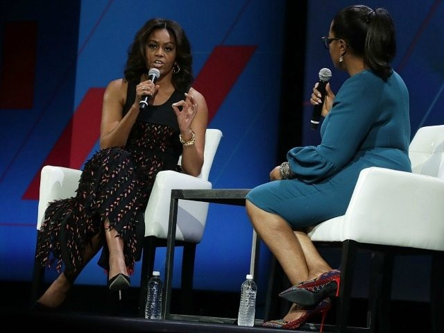Michelle Obama (L) and Oprah Winfrey (R) participate in a conversation on 'Trailblazing the Path for the Next Generation of Women' during the White House Summit on the United State Of Women June 14, 2016 in Washington, DC.