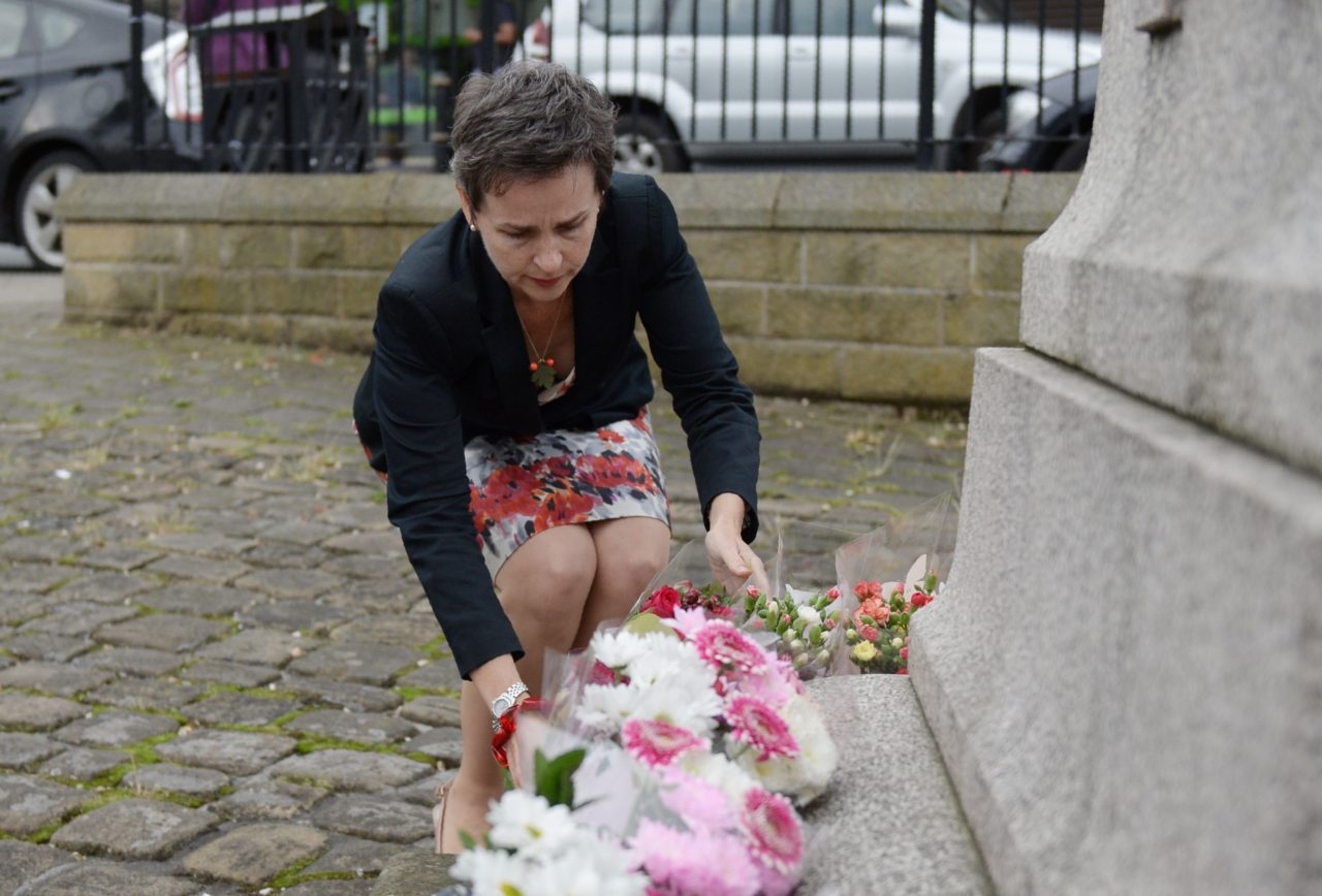 Labour MP Mary Creagh lays flowers at a statue to Joseph Priestly in Birstall near to the scene where Labour MP Jo Cox was shot on June 16, 2016. A British lawmaker died today after a shock daylight street attack, throwing campaigning for the referendum on Britain's membership of the European Union into disarray just a week before the crucial vote. / AFP / OLI SCARFF (Photo credit should read OLI SCARFF/AFP/Getty Images)