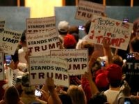 Supporters of Republican presidential candidate Donald Trump hold signs on June 16, 2016 at Gilley's in Dallas, Texas.