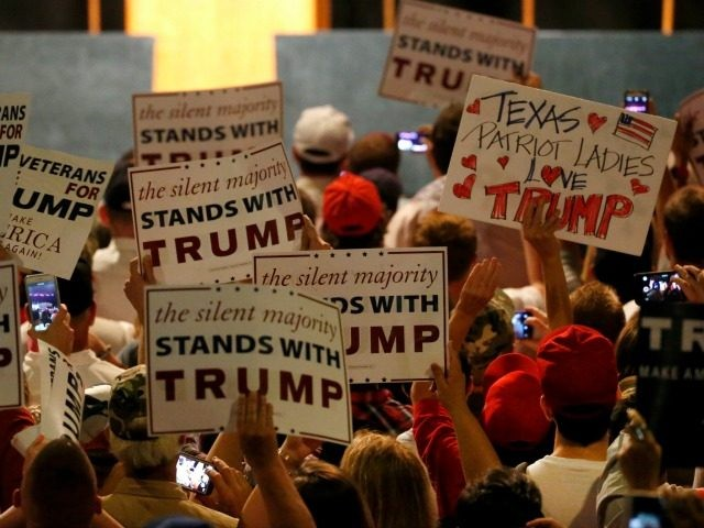 Supporters of Republican presidential candidate Donald Trump hold signs on June 16, 2016 at Gilley