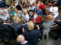 Republican presidential candidate Donald Trump (C) greets supporters following a campaign rally on June 18, 2016 in Phoenix, Arizona.