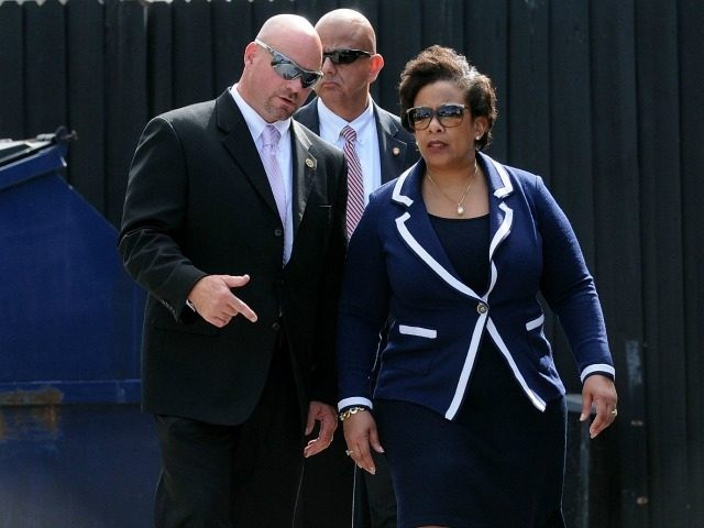 Attorney General Loretta Lynch (R) and FBI agent Ronald Hopper visit the Pulse nightclub crime scene on June 21, 2016 in Orlando, Florida.