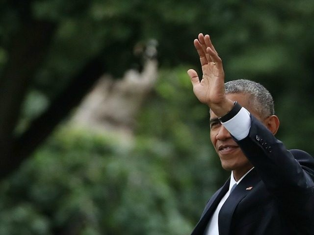 President Barack Obama waves as he walks toward Marine One while departing from the South Lawn of the White House, June 23, in Washington, DC. President Obama is traveling to San Jose, California to attend the Global Entrepreneurship Summit on Friday. (Photo by )