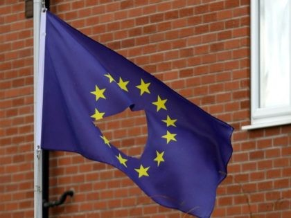 KNUTSFORD, UNITED KINGDOM - JUNE 24: A European Union flag, with a hole cut in the middle, flys at half mast outside a home in Knutsford Cheshire after today's historic referendum on June 24, 2016 in Knutsford, United Kingdom. The results from the historic EU referendum has now been declared …