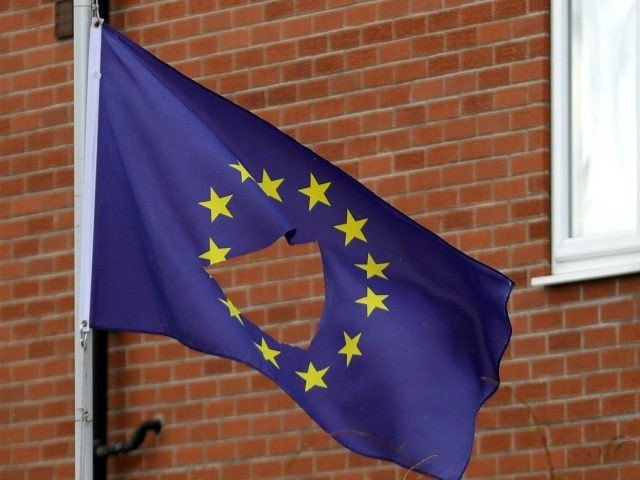 KNUTSFORD, UNITED KINGDOM - JUNE 24:  A European Union flag, with a hole cut in the middle, flys at half mast outside a home in Knutsford Cheshire after today's historic referendum on June 24, 2016 in Knutsford, United Kingdom. The results from the historic EU referendum has now been declared and the United Kingdom has voted to LEAVE the European Union.  (Photo by )