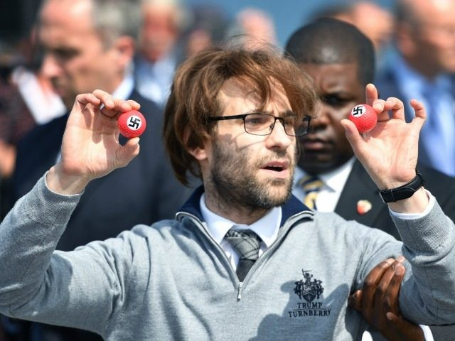 Comedian Lee Nelson is taken away by security while holding golf balls stamped with swastika as he protests against Presumptive Republican nominee for US president Donald Trump a he gave a press conference on the 9th tee at his Trump Turnberry Resort on June 24, 2016 in Ayr, Scotland. Mr …