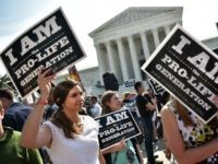 nti-abortion activists hold placards before a US Supreme Court ruling on a Texas law placing restrictions on abortion clinics, outside of the Supreme Court on June 27, 2016 in Washington, DC. In a case with far-reaching implications for millions of women across the United States, the court ruled 5-3 to strike down measures which activists say have forced more than half of Texas's abortion clinics to close.