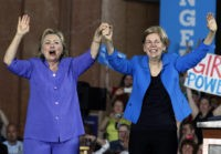 CINCINNATI, OH- JUNE 27:  Democratic Presidential candidate Hillary Clinton (L) and U.S. Sen Elizabeth Warren (D-MA) (R) wave to the crowd before a campaign rally at the Cincinnati Museum Center at Union Terminal June 27, 2016 in Cincinnati, Ohio. Warren is helping Clinton campaign in Ohio.   (Photo by John Sommers II/Getty Images)