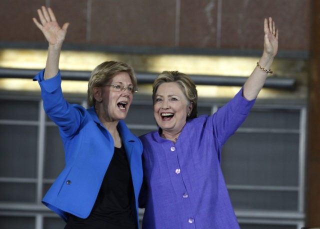 CINCINNATI, OH- JUNE 27: Democratic Presidential candidate Hillary Clinton (R) and U.S. Sen Elizabeth Warren (D-MA) wave to the crowd before a campaign rally at the Cincinnati Museum Center at Union Terminal June 27, 2016 in Cincinnati, Ohio. Warren is helping Clinton campaign in Ohio. (Photo by John Sommers II/Getty …
