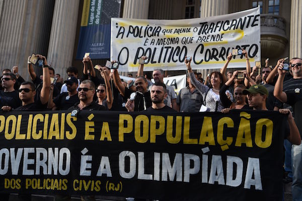 "Civil police officers threatening to go on strike demonstrate against the government for arrears in their salary payments, in Rio de Janeiro, Brazil, June 27, 2016, t Earlier this month, Rio state authorities declared a ""state of public calamity"" over a major budget crisis in order to release emergency funds to finance the Olympic Games due to begin in August. / AFP / VANDERLEI ALMEIDA (Photo credit should read VANDERLEI ALMEIDA/AFP/Getty Images)"