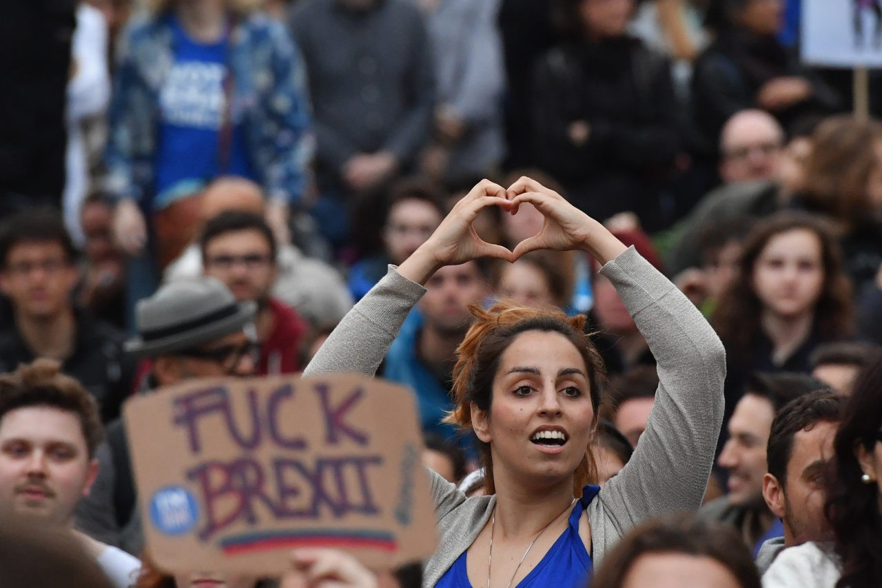 LONDON, ENGLAND - JUNE 28: (EDITORS NOTE: Image contains profanity.) Protesters gather against the EU referendum result in Trafalgar Square on June 28, 2016 in London, England. Up to 50,000 people were expected before the event was cancelled due to safety concerns. Early evening up to 300 people have still converged on the square to vent their anti-Brexit feelings. (Photo by Jeff J Mitchell/Getty Images)
