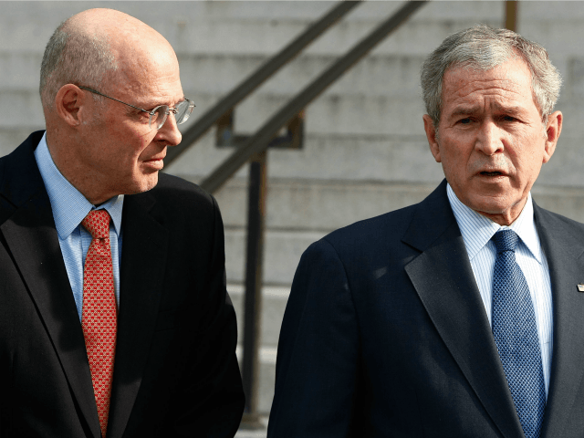 President George W. Bush (R) is joined by Treasury Secretary Henry Paulson while making a statement to the news media after a meeting at the Treasury Department November 24, 2008 in Washington, DC.