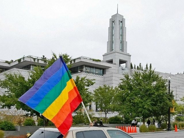 A car flies the gay pride flag in protest past the Mormon Conference center during the 179th Semi-Annual General Conference of the Mormon church on October 3, 2009 in Salt Lake City, Utah.